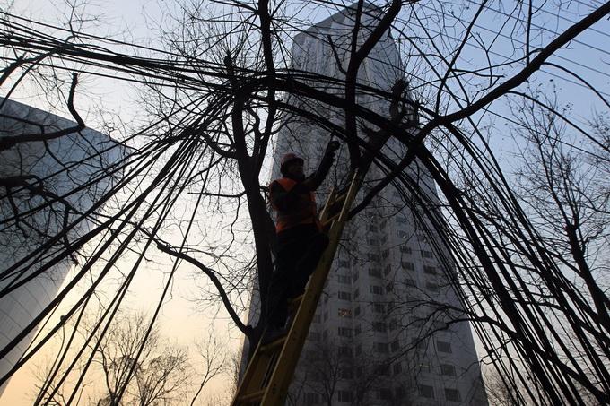 凤凰彩票网址:北京核心区启动电力架空线入地工程_让市民抬头看到澄净天空